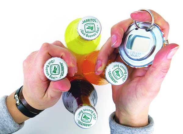 woman holding bottle opener with Jarritos bottles