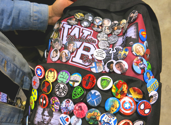 comic con buttons on backpack