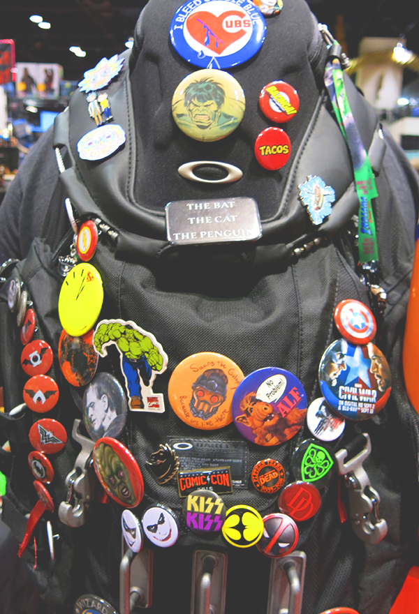 wom wearing comic con buttons on lanyard